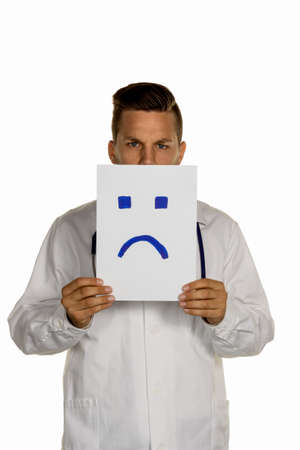 a doctor holds a negative smily front of your face