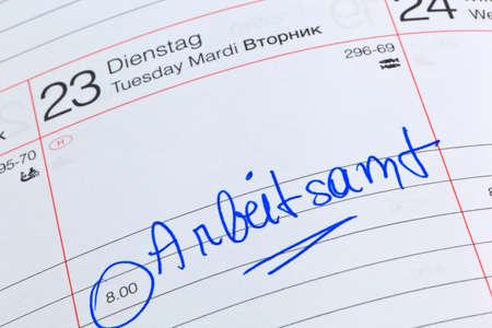 entlassen: an appointment is entered on a calendar: labour office