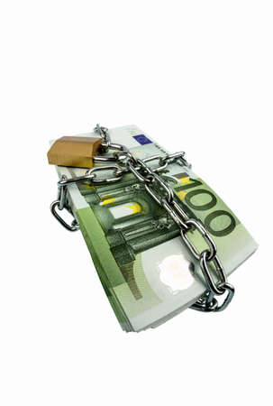 monetary devaluation: euro banknotes with chain and padlock. photo icon for security and inflation. Stock Photo