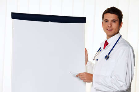 pracitioner: successful businessman with a flip chart in a presentation in meeting Stock Photo