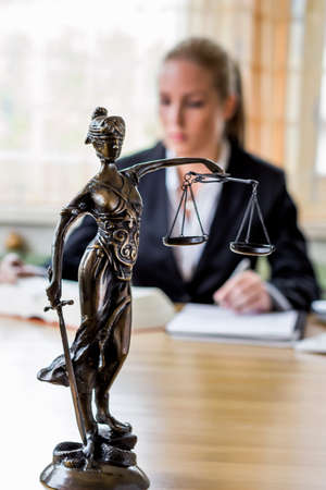 criminal defense: businesswoman sitting in an office. photo icon for managers, independence or lawyer. Stock Photo