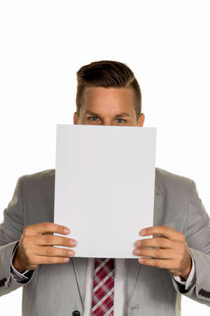 collective bargaining: a young businessman holding a blank sheet over her face. Stock Photo
