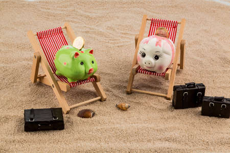a piggy bank is in a deck chair. symbolic photo for airline travel and expenses on vacation photo