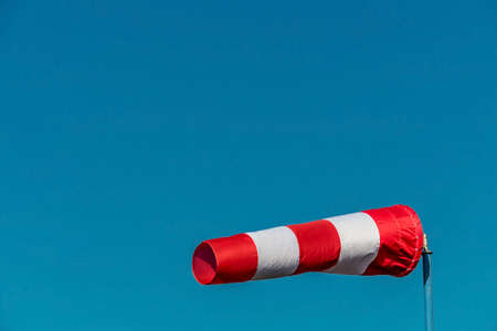 climate change: a windsock inflated by the wind. photo icon for power and success