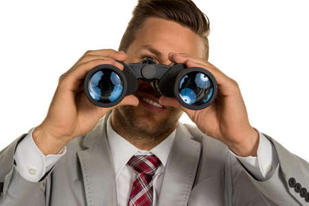 doldrums: a manager with binoculars looking for jobs or jobs