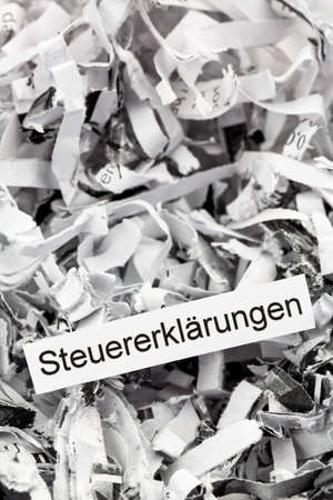 tax aligned: tagged with shredded paper tax returns, symbolic photo for tax burden and retention requirements