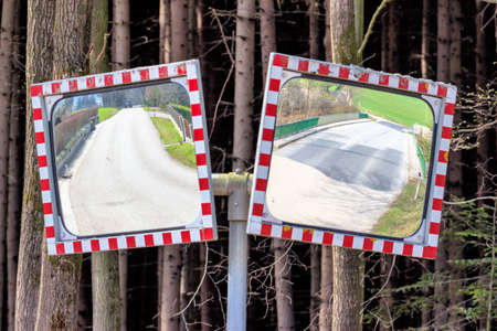 peasantry: two traffic mirror stand at the intersection of a road