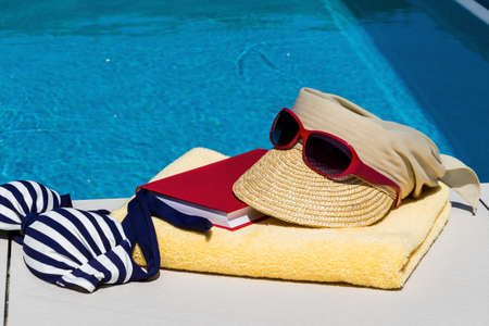 pool symbol: utensils for a nice relaxing vacation day lying next to a swimming pool. relaxation on vacation. Stock Photo