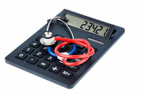 physicans: stethoscope and calculator, symbolic photo for billing and medical costs