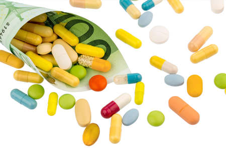 one hundred euro banknote: tablets and one hundred euro banknote symbol photo: charges for medicine and drugs the pharmaceutical industry