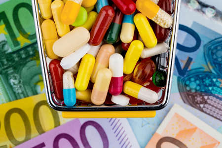 pharmaceutical drug: tablets, shopping cart, euro notes, symbolic photo for pharmaceuticals, health insurance, health care costs Stock Photo
