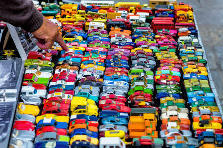 many colorful toy cars, a symbol of childhood hobby, collecting