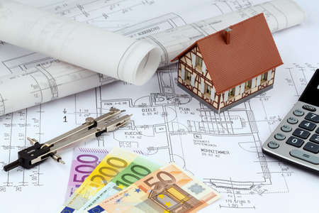 modell: an architects blueprint with euro money. symbolic photo for funding and planning of a new home. Stock Photo