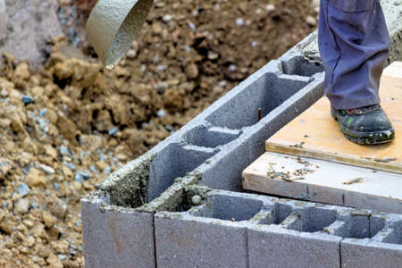 work worker workforce world: scarf stones are filled with concrete. concrete work on a construction site of a house