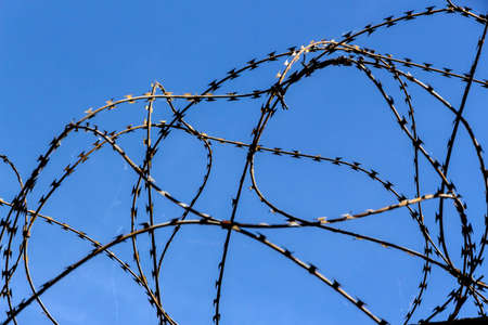remand: a site is protected with barbed wire