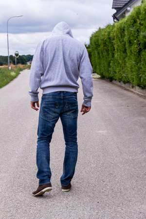 a man walks alone on a path. Stock Photo