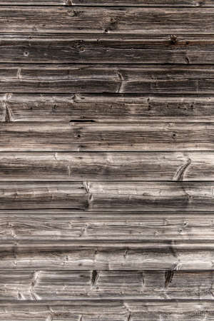 a wooden wall of old boards built. concept photo for background Stock Photo