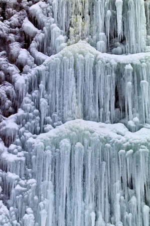 icescape: a frozen by the cold waterfall. icy waterfall in winter.