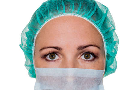 klinik: a nurse or doctor in surgical clothing before surgery. symbolic photo for stress and overtime in the hospital.