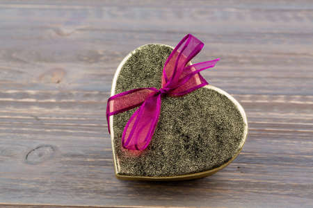 cordially: a box for a gift in the form of a heart. photo icon for valentines day, wedding, engagement.