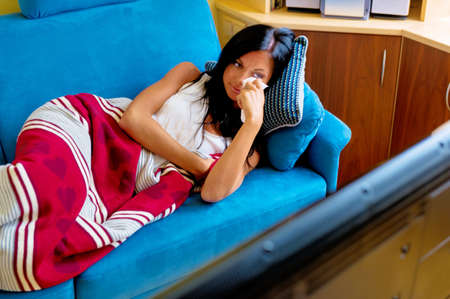 tonight: a young woman sees a sad movie on tv Stock Photo