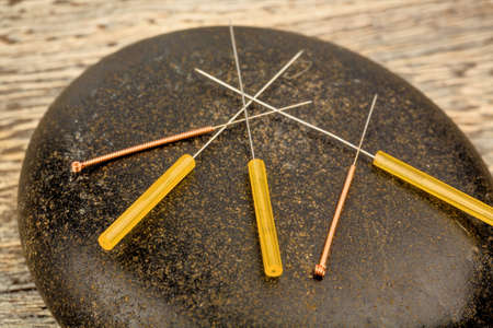 naturopaths: several needle for acupuncture are adjacent. t