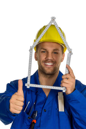 work worker workforce world: a worker in an industrial enterprise with helmet wants to build a house.