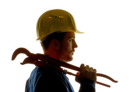 a worker in an industrial enterprise with tools in hand Stock Photo
