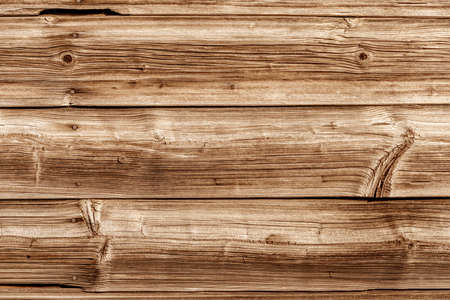 knothole: a wooden wall of old boards built. concept photo for background Stock Photo