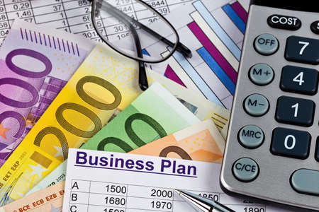 reestablishment: a business plan for starting a business. ideas and strategies to start a business. euro banknotes and calculator Stock Photo