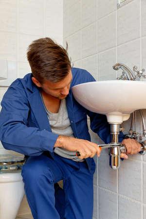 hobbyist: a plumber  at work Stock Photo