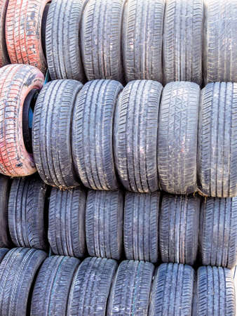 fcc: stack of worn tires, symbolic photo for car tires, safety, accident risk Stock Photo