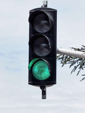 restart: a traffic light with green light. symbolic photo for free travel, and economic success Stock Photo