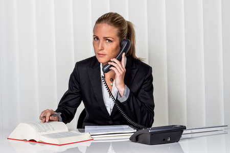 businesswoman sitting in an office. photo icon for managers, independence or lawyer. Stock Photo