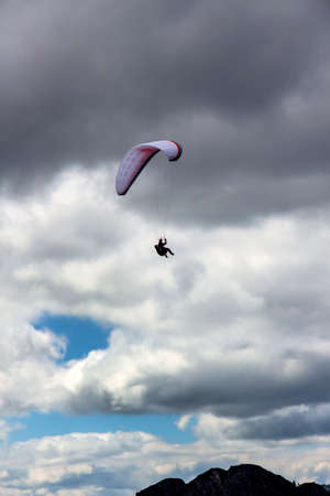 freetime activity: a flight with a paraglider by the beautiful mountains of austria is always an experience