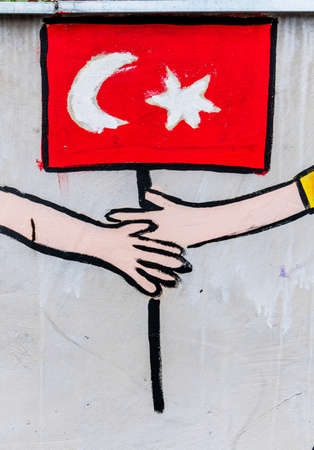 accession: on the wall of a school children have students painted. symbolic photo for coexistence and migration