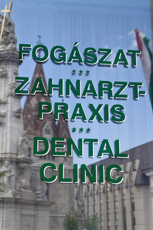 surgery expenses: sign of a dentist in budapest, hungary. hungarian dentists are cheaper. Editorial