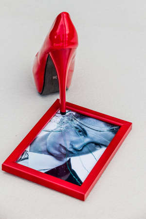 zerbrochner photo frames and high heels. symbolic photo for divorce, separation and relationship crisis photo