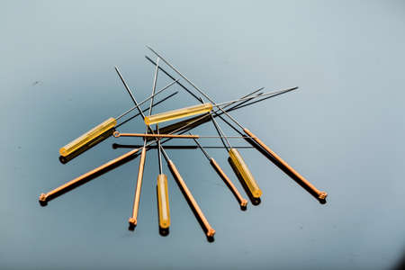 naturopaths: several needle for acupuncture are adjacent. Stock Photo