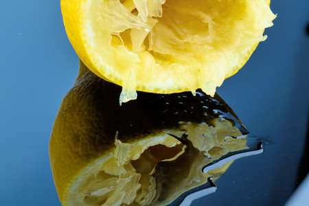 one of squeezed lemon on a white background. symbolic photo for taxes, duties,