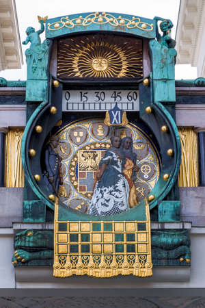'pull over': the anchor clock in vienna, austria hoher markt. art nouveau art clock. at 12:00 clock pull over 12 figures in the history of vienna for organ sounds on the dial.