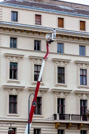 live work city: lift of a residential building, symbol of repair, maintenance, building management