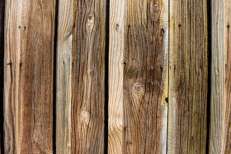 knothole: an old wooden wall of a barn. ideal for background Stock Photo