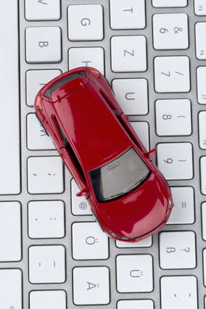 fcc: car on keyboard symbol photo for car buying and car trade on the internet Stock Photo