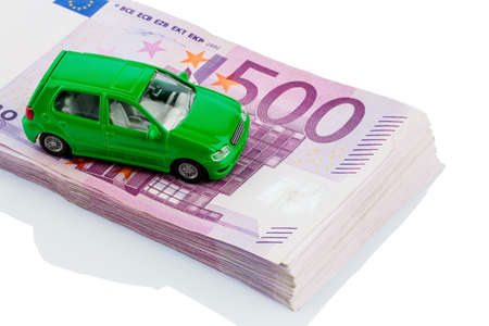 fully comprehensive: green model car on banknotes, symbolic photograph for car purchase, financing and costs