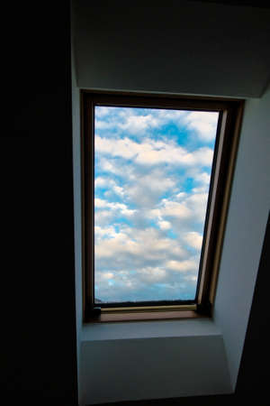 roof apartment: sky, clouds, roof windows, roof apartment with a view of the clouds