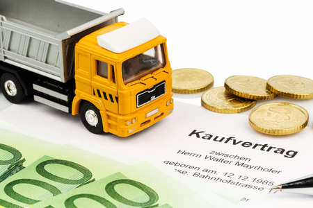 reduces: a purchase contract for new trucks. invest in new vehicles reduces operating costs. Stock Photo
