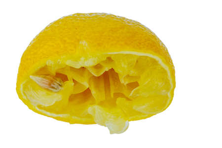 household money: a squeezed lemon on a white background. symbolic photo for taxes and fees.