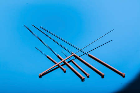 adjacent: several needle for acupuncture are adjacent. Stock Photo