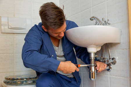 a plumber  at work Stock Photo